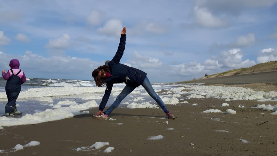 trikonasana on the beach